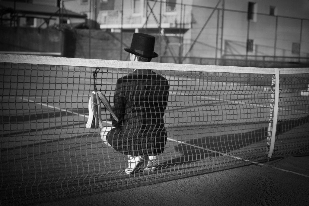 Man with Hat - Tennis court 3