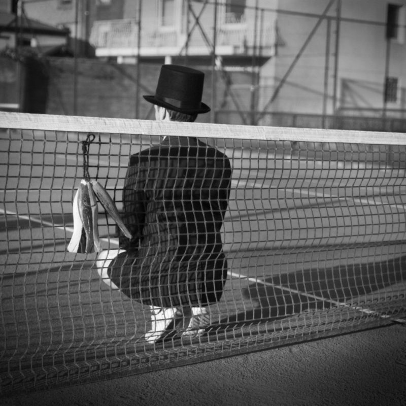 Man with Hat - Tennis court 3