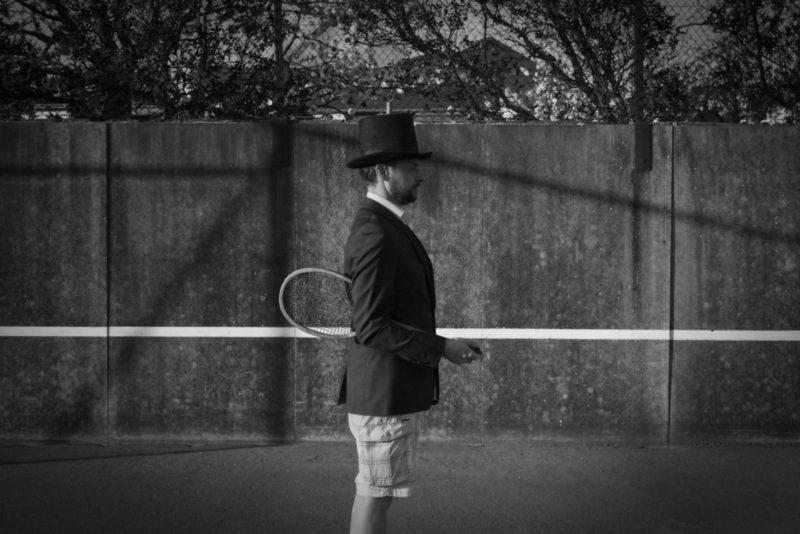 Man with Hat – Tennis Court 1
