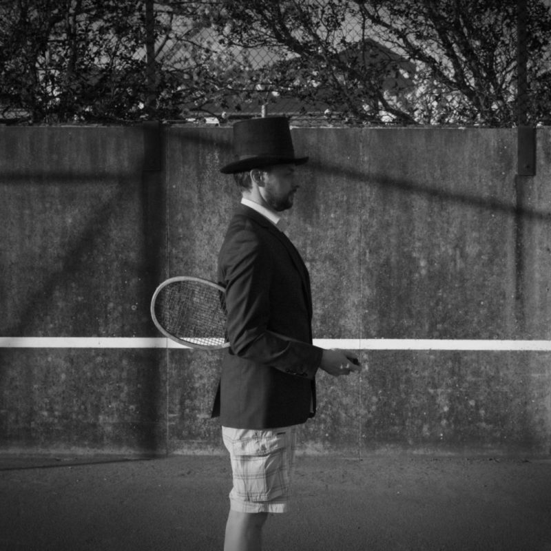 Man with Hat - Tennis Court